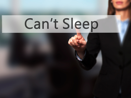 cant: Cant Sleep - Isolated female hand touching or pointing to button. Business and future technology concept. Stock Photo