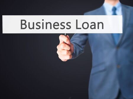 lend: Business Loan - Business man showing sign. Business, technology, internet concept. Stock Photo