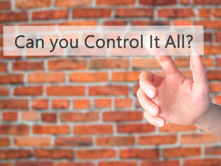 oversight: Can you Control It All ? - Hand pressing a button on blurred background concept . Business, technology, internet concept. Stock Photo