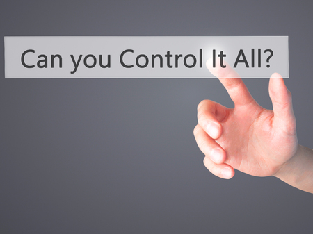 overseer: Can you Control It All ? - Hand pressing a button on blurred background concept . Business, technology, internet concept. Stock Photo