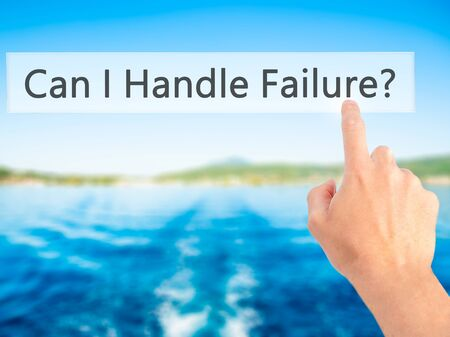 loss leader: Can I Handle Failure? - Hand pressing a button on blurred background concept . Business, technology, internet concept. Stock Photo