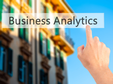 rotulador: Business Analytics - Hand pressing a button on blurred background concept . Business, technology, internet concept. Stock Photo