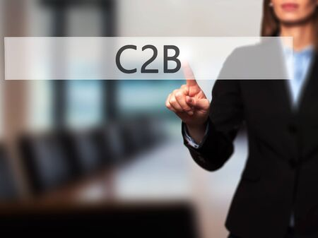 sourcing: C2B - Businesswoman pressing high tech  modern button on a virtual background. Business, technology, internet concept. Stock Photo