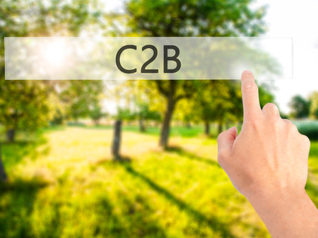 sourcing: C2B - Hand pressing a button on blurred background concept . Business, technology, internet concept. Stock Photo
