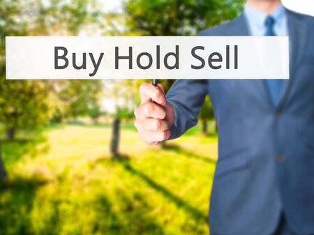 Buy Hold Sell - Business man showing sign. Business, technology, internet concept. Stock Photo