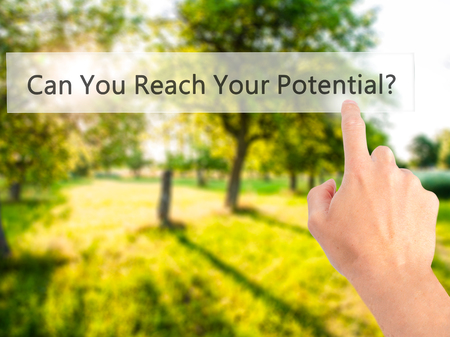 Can You Reach Your Potential ? - Hand pressing a button on blurred background concept . Business, technology, internet concept. Stock Photo Stock Photo