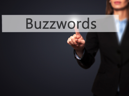 composing: Buzzwords - Businesswoman pressing high tech  modern button on a virtual background. Business, technology, internet concept. Stock Photo Stock Photo