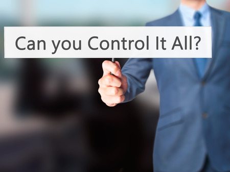 overseer: Can you Control It All ? - Business man showing sign. Business, technology, internet concept. Stock Photo Stock Photo