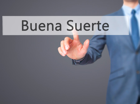 goodluck: Buena Suerte ( Good Luck in Spanish) - Businessman click on virtual touchscreen. Business and IT concept. Stock Photo