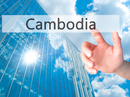 Cambodia - Hand pressing a button on blurred background concept . Business, technology, internet concept. Stock Photo Stock Photo