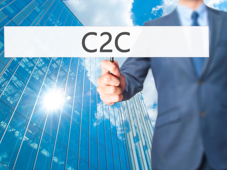 C2C - Business man showing sign. Business, technology, internet concept. Stock Photo