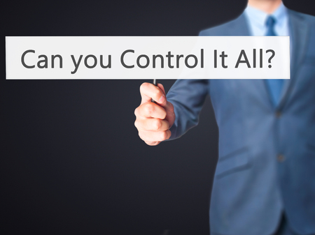 oversight: Can you Control It All ? - Business man showing sign. Business, technology, internet concept. Stock Photo Stock Photo
