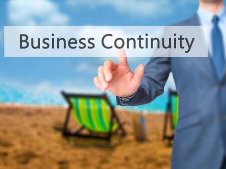 continuity: Business Continuity - Businessman click on virtual touchscreen. Business and IT concept. Stock Photo