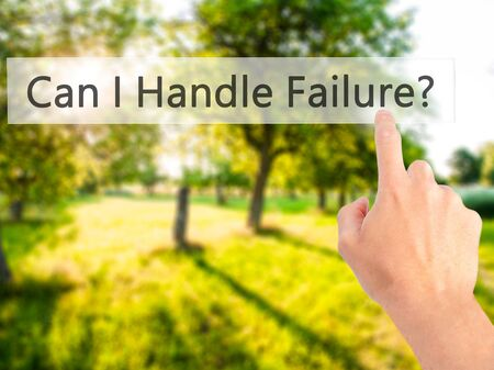 Can I Handle Failure? - Hand pressing a button on blurred background concept . Business, technology, internet concept. Stock Photo