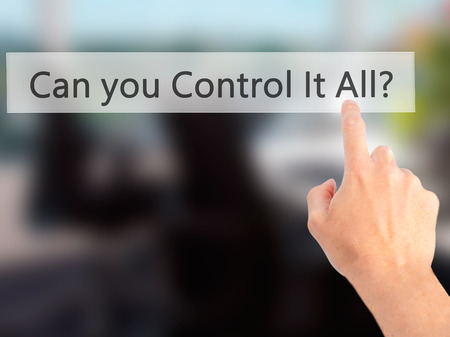 overwhelming: Can you Control It All ? - Hand pressing a button on blurred background concept . Business, technology, internet concept. Stock Photo