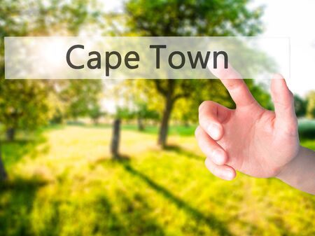 Cape Town - Hand pressing a button on blurred background concept . Business, technology, internet concept. Stock Photo