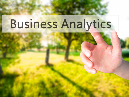 estimating: Business Analytics - Hand pressing a button on blurred background concept . Business, technology, internet concept. Stock Photo
