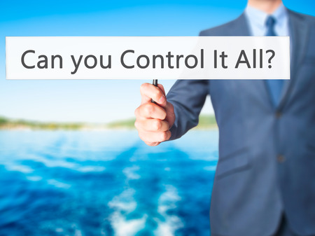 multitask: Can you Control It All ? - Business man showing sign. Business, technology, internet concept. Stock Photo Stock Photo