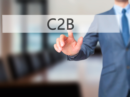 reverse: C2B - Businessman click on virtual touchscreen. Business and IT concept. Stock Photo