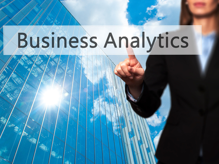 estimating: Business Analytics - Businesswoman pressing high tech  modern button on a virtual background. Business, technology, internet concept. Stock Photo