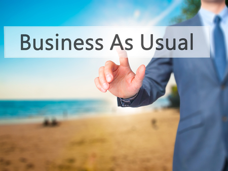 predictable: Business As Usual - Businessman click on virtual touchscreen. Business and IT concept. Stock Photo
