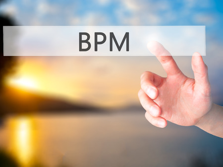 bpm: BPM (Business Process Management) - Hand pressing a button on blurred background concept . Business, technology, internet concept. Stock Photo Stock Photo