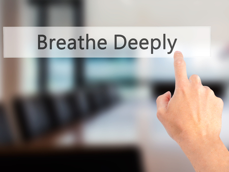 deeply: Breathe Deeply - Hand pressing a button on blurred background concept . Business, technology, internet concept. Stock Photo Stock Photo