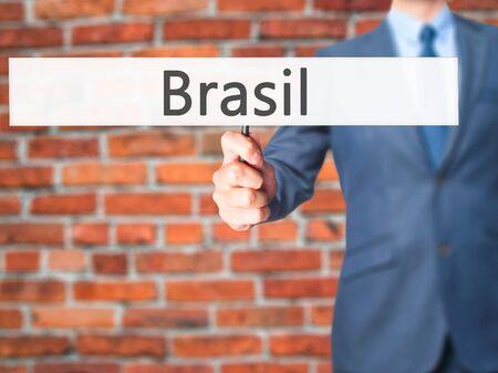 cataract falls: Brasil - Businessman hand holding sign. Business, technology, internet concept. Stock Photo