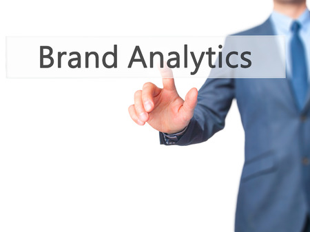 brand monitoring: Brand Analytics - Businessman hand touch  button on virtual  screen interface. Business, technology concept. Stock Photo