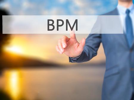 bpm: BPM (Business Process Management) - Businessman hand touch  button on virtual  screen interface. Business, technology concept. Stock Photo Stock Photo