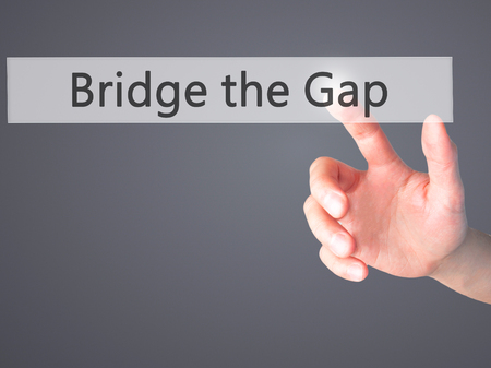 bridging the gap: Bridge the Gap - Hand pressing a button on blurred background concept . Business, technology, internet concept. Stock Photo