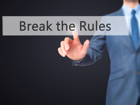 disobey: Break the Rules - Businessman hand touch  button on virtual  screen interface. Business, technology concept. Stock Photo Stock Photo