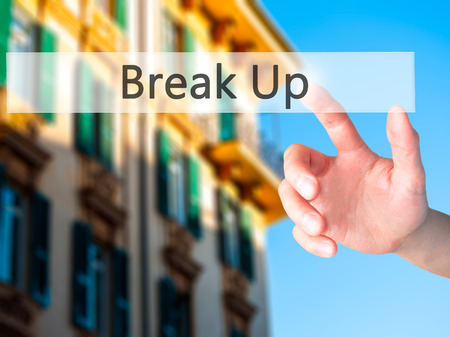 game over: Break Up - Hand pressing a button on blurred background concept . Business, technology, internet concept. Stock Photo
