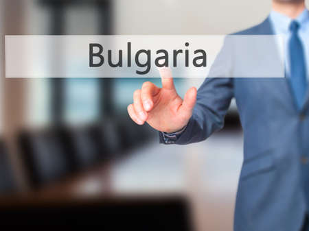foothills: Bulgaria - Businessman hand touch  button on virtual  screen interface. Business, technology concept. Stock Photo