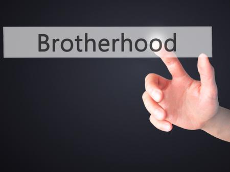 brotherhood: Hermandad - Mano presionando un botón en concepto de fondo borroso. Negocios, la tecnología, el concepto de internet. Foto de stock