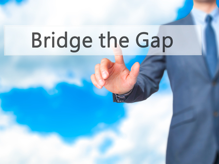 bridge the gap: Bridge the Gap - Businessman hand touch  button on virtual  screen interface. Business, technology concept. Stock Photo