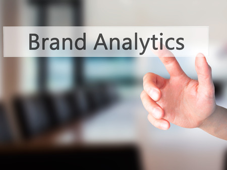 brand monitoring: Brand Analytics - Hand pressing a button on blurred background concept . Business, technology, internet concept. Stock Photo Stock Photo
