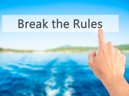 break the rules: Break the Rules - Hand pressing a button on blurred background concept . Business, technology, internet concept. Stock Photo