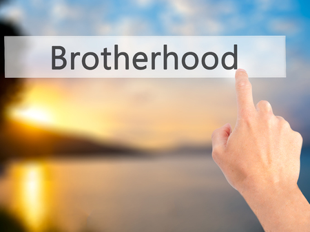 brotherhood: Brotherhood - Hand pressing a button on blurred background concept . Business, technology, internet concept. Stock Photo