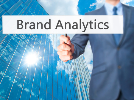 brand monitoring: Brand Analytics  - Businessman hand holding sign. Business, technology, internet concept. Stock Photo