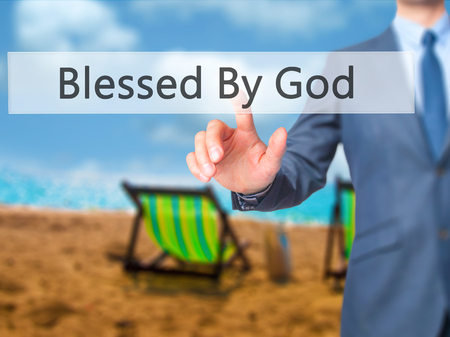 god button: Blessed By God - Businessman hand touch  button on virtual  screen interface. Business, technology concept. Stock Photo