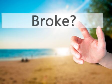 lay off: Broke - Hand pressing a button on blurred background concept . Business, technology, internet concept. Stock Photo