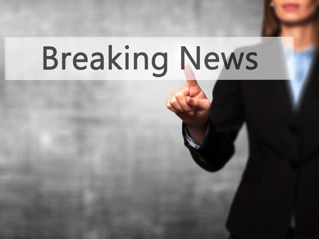 annoucement: Breaking News - Businesswoman pressing modern  buttons on a virtual screen. Concept of technology and  internet. Stock Photo Stock Photo