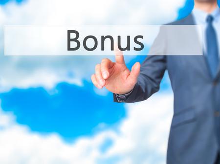 Bonus - Businessman hand touch  button on virtual  screen interface. Business, technology concept. Stock Photo