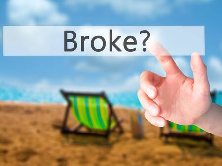 Broke - Hand pressing a button on blurred background concept . Business, technology, internet concept. Stock Photo