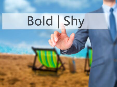 timid: Bold Shy - Businessman hand touch  button on virtual  screen interface. Business, technology concept. Stock Photo
