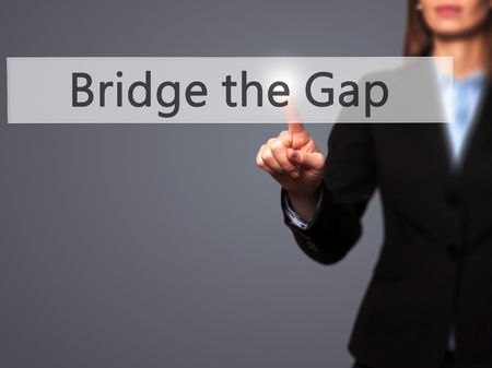 bridging the gap: Bridge the Gap - Businesswoman pressing modern  buttons on a virtual screen. Concept of technology and  internet. Stock Photo Stock Photo