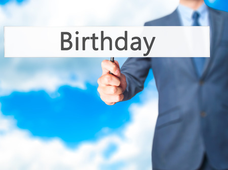 Birthday - Businessman hand holding sign. Business, technology, internet concept. Stock Photo Stock Photo