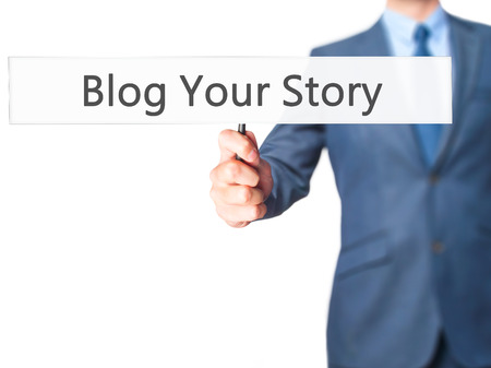 photo story: Blog Your Story - Businessman hand holding sign. Business, technology, internet concept. Stock Photo