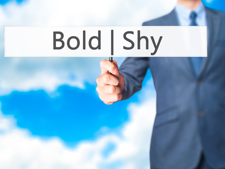 bashful: Bold Shy - Businessman hand holding sign. Business, technology, internet concept. Stock Photo Stock Photo